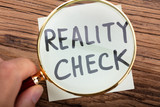 Looking At Reality Check Word Through Magnifying Glass - 221373471