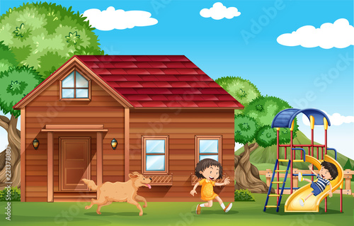 Children playing outside with dog - 221378080