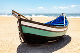 Fishing boat on the beach of Nazare in Portugal - 221391649