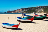 Fishing boat on the beach of Nazare in Portugal - 221391664