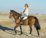 riding girl and horse - 221392600