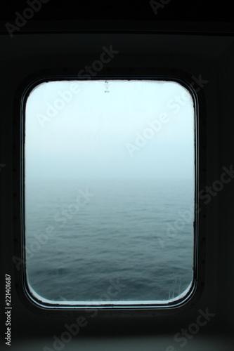 Ship cabin window view: northern sea - 221401687