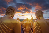 Magha Puja Memorial Buddhist Park with many of golden buddha statues while beautiful sunset in Nakorn Nayok, Thailand.  - 221403090