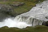 Waterfall in iceland from above: icelandic landscape in a cloudy day