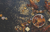 Sweet food background, assorted white and brown sugar on a dark background, top view - 221407047