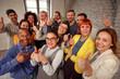 Leinwanddruck Bild - Group of businessman and businesswoman team giving thumb up sign of success business teamwork.
