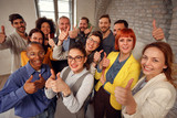 Group of businessman and businesswoman team giving thumb up sign of success business teamwork.