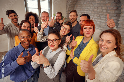 Group of businessman and businesswoman team giving thumb up sign of success business teamwork. - 221422635