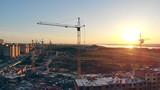 Construction crane at a construction site 4K. - 221424228