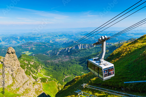 cable car on the ropes, going to Mount Kasprowy Wierch, Poland. Beautiful view of the valley