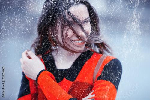 Leinwanddruck Bild rainy weather girl posing fall / raindrops, spray, girl adult on a rain background