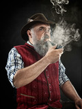dramatic portrait of gray bearded senior man in hat smoking tobacco pipe. view of Austrian, Tyrolean, Bavarian old man in national traditional costume in retro style. - 221427864