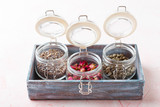 Dried rose flower buds and flowers in glass jars. Herbal tea, cleansing, organic bio products - 221431278