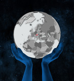 Austria on globe in hands - 221443437
