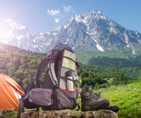 Hiking equipment and camping tent in mountains - 221450475