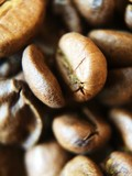 Roasted coffee beans on the table close up - 221462267