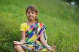 A little girl in a colorful Sari - 221470071