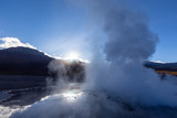 Steam clouds rising at dawn in the El Tatio geyser field,  Atacama desert in the Andes Mountains, Chile  - 221480433