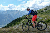 mountainbiker in action in the beautiful aosta valley, Italy, Europe