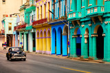 Street scene with old classic car and colorful buildings in Havana