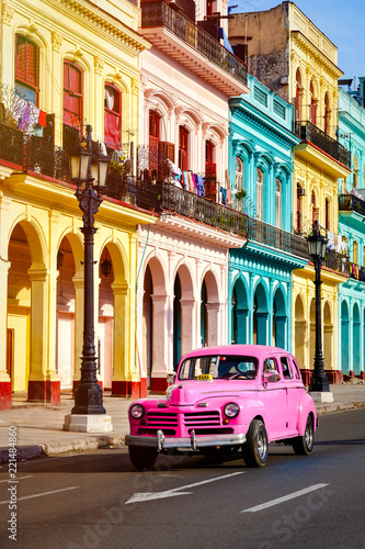 Classic car and colorful buildings at sunset in Old Havana - 221484860