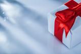 Red present box on white background horizontal image - 221490698