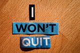 News paper cutting words placed on a wooden background, says I won't quit - 221496678