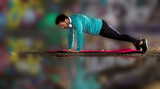 Sportsman doing pushups beside water - 221498251