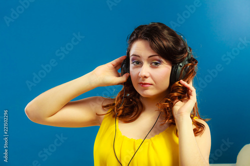 girl in big headphones listening music mp3 relaxing - 221502296