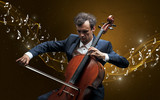 Lonely musical composer with cello and sparkling musical notes around - 221513688