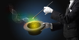 Illusionist hand starts to conjure with white glove and magic wand - 221513874