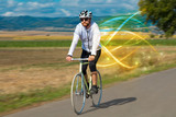 Young cyclist riding bicycle with magical landscape and concept - 221514268