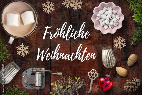 """Leinwandbild Motiv weihnachtlich Dekoration und Nachricht """"Fröhliche Weihnachten"""" auf rustikalem Holzuntergrund"""