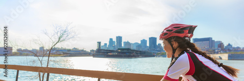 Biking woman ridig city bike panoramic banner landscape -Cyclist girl in summer outdoor background.