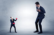 Leinwanddruck Bild - Big businessman being afraid of small masked businessman with box gloves in an empty room concept