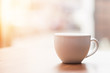 Coffee cup on wooden table in the morning with gold light feeling warm,Selective focus - 221523487
