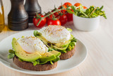 Avocado toast, cherry tomato and poached eggs on wooden background. Breakfast with vegetarian food, healthy diet concept. - 221545667