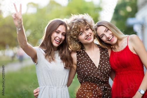Leinwanddruck Bild Group Of Three Female Friends Having Fun Together