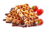 waffles with strawberries and chocolate sauce - 221555218