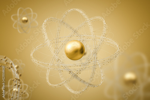 Gold atom model over yellow background