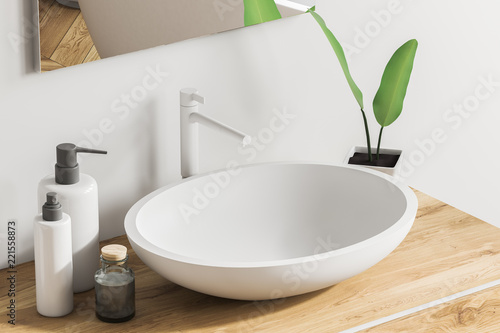 Close Up Of Sink On Wooden Vanity Unit White