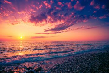 Scenic colorful sunset above sea. Seascape background