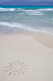 The symbol of sun drawing on the sand. Chrissi island in Crete, Greece.