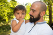 cheerful family single beard man with chid boy in arms