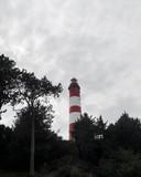 Leuchtturm Amrum vor bewölktem Himmel - 221566886