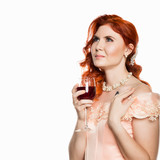 Young redhead dreamy woman drinks a red wine with a happy face and smiling. White background. free space for your text - 221571833