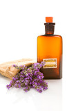 Bottle with aroma oil and lavender flowers isolated on white. Aromatherapy. - 221572237