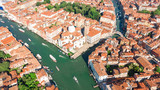 Aerial drone view of Venice city Grand Canal, island cityscape and Venetian lagoon from above, Italy  - 221575083