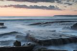 Beautiful dramatic Sunset over a rocky coast - 221578285