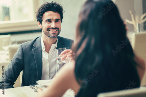 Cheerful couple in a restaurant - 221601011